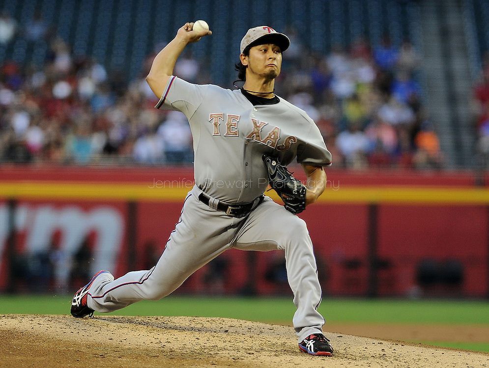 PHOENIX, AZ - MAY 27:  Pitcher Yu Darvish #11 of the Texas Rangers pitches against the Arizona Diamondbacks durng an interleague game at Chase Field on May 27, 2013 in Phoenix, Arizona.  The Diamondbacks defeated the Rangers 5-4.  (Photo by Jennifer Stewart/Getty Images) *** Local Caption *** Yu Darvish