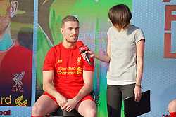 LIVERPOOL, ENGLAND - Monday, May 9, 2016: Liverpool's captain Jordan Henderson is interviewed by Claire Rourke at the launch of the New Balance 2016/17 Liverpool FC kit at a live event in front of supporters at the Royal Liver Building on Liverpool's historic World Heritage waterfront. (Pic by David Rawcliffe/Propaganda)