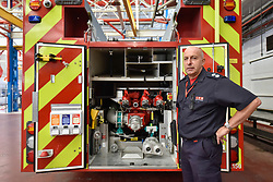 © Licensed to London News Pictures. 09/09/2017. London, UK. Monty, a fireman from Hainault, is seen with the current Mercedes Benz 1327F E1 DPL150 2016 fire engine on show at London Fire Brigade's annual Fire Engine Festival in Lambeth. The earliest motorised fire engines still working, London Fire Brigade's brand new pump as well firefighter uniforms are on display. Photo credit : Stephen Chung/LNP