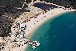 "21.06.2015, Zrce, Insel Pag, CRO, Der Strand Zrće befindet sich unweit der kroatischen Stadt Novalja auf der Insel Pag in Norddalmatien. Seit der Unabhängigkeit Kroatiens entwickelte sich der Strand Zrće zu einer Partymeile der Jugend und ist als ""Ibiza Kroatiens"" bekannt, im Bild Zrce is a long pebble beach on the Adriatic island of Pag // Zrće beach is located near the Croatian town of Novalja on Pag island in North Dalmatia. Since Croatia's independence, the beach Zrće has developed into a party area of youth and is known as the ""Ibiza of Croatia"", pictured on 2015/06/12 in Zrce in Insel Pag, Croatia on 2015/06/21. EXPA Pictures © 2015, PhotoCredit: EXPA/ Pixsell/ Dino Stanin<br /> <br /> *****ATTENTION - for AUT, SLO, SUI, SWE, ITA, FRA only*****"