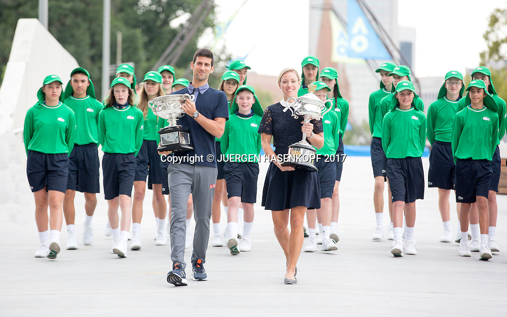 NOVAK DJOKOVIC (SRB) und ANGELIQUE KERBER (GER) praesentieren ihre Australian Open 2016 Pokale.<br /> <br /> Australian Open 2017 -  Melbourne  Park - Melbourne - Victoria - Australia  - 13/01/2017.