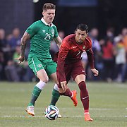 Cristiano Ronaldo, Portugal, challenged by Jeff Hendrick, Ireland, during the Portugal V Ireland International Friendly match in preparation for the 2014 FIFA World Cup in Brazil. MetLife Stadium, Rutherford, New Jersey, USA. 10th June 2014. Photo Tim Clayton