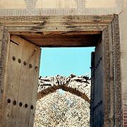 25 November 1976<br /> Kabul. Heavy metal studs. Damaged arch behind.