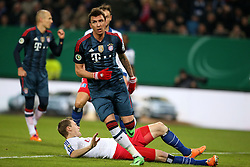 Football: Germany, DFB Cup<br /> Marcell Jansen (Hamburger SV, HSV) - <br /> Mario Mandzukic (FC Bayern Muenchen) scores the first goal