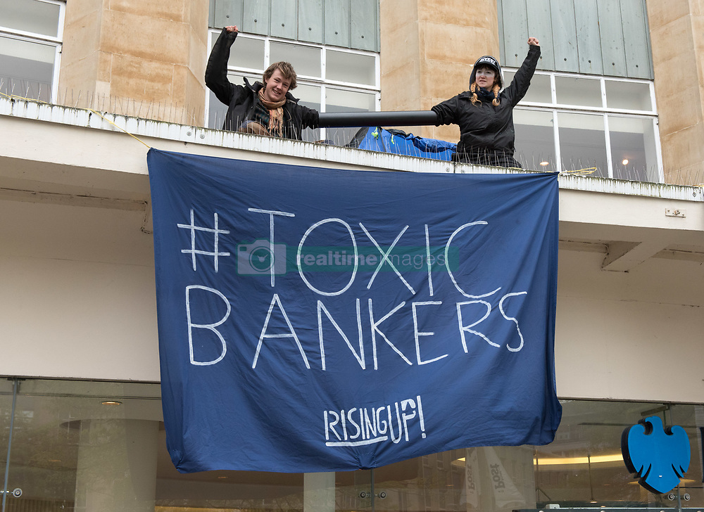 May 4, 2017 - Bristol, UK - Bristol - Anti-fracking protest activists from 'Rising Up' lock themselves together with their arms in a tube on top of Barclays Bank in Broadmead shopping centre. Police removed the two protesters with help from the fire brigade's turntable ladder, and both rooftop protesters were arrested plus another person was arrested on suspicion of writing slogans using chalk on the pavement. The protest is a prelude to Global Divestment in Fossil Fuels day on Friday 05 May and 06 May. (Credit Image: © Simon Chapman/London News Pictures via ZUMA Wire)