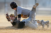 Mitchell shortstop Drew Kitchens looks to the official for the call after getting the tag on Harrisburg's Jack Teigen at second during the first game of a doubleheader on Wednesday at Drake Field. (Matt Gade / Republic)