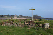 A coastal landscape of St. Cuthbert's Island on Holy Island and in the distance, left, the St. Mary's church and the remains of the early 12th century Lindisfarne Priory, on 27th September 2017, on Lindisfarne Island, Northumberland, England. Cuthbert (c. 634 - 687) is a saint of the early Northumbrian church in the Celtic tradition. He was a monk, bishop and hermit, associated with the monasteries of Melrose and Lindisfarne in what might loosely be termed the Kingdom of Northumbria in the North East of England and the South East of Scotland. After his death he became one of the most important medieval saints of Northern England, with a cult centred on his tomb at Durham Cathedral. Cuthbert is regarded as the patron saint of Northern England. The Holy Island of Lindisfarne, also known simply as Holy Island, is an island off the northeast coast of England. Holy Island has a recorded history from the 6th century AD; it was an important centre of Celtic and Anglo-saxon Christianity. After the Viking invasions and the Norman conquest of England, a priory was reestablished.