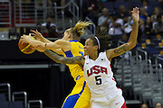 Team USA forward Seimone Augustus (5) battles Team Brazil Nadia Colhado (13) for the loose ball during the 2012 USA Women's Basketball Team versus Brazil at Verizon Center in Washington, DC.  July 16, 2012  (Photo by Mark W. Sutton)