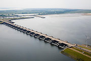 Nederland, Zuid-Holland, Goeree-Overflakkee, 04-07-2006; dam and sluices between islands Goeree-Overflakkee en Voorne-Putten; the sluices are for sluicing water coming from the rivers Rhine and Maas (Meuse) from the naturabassin (bottom part of the photo) to the North sea (top right); Haringvlietdam met Haringvlietsluizen, gezien in de richting Goedereede en Ouddorp op Goeree-Overflakkee; de sluizen zijn spui-sluizen en zorgen er voor dat het zoete water uit het Haringvliet (links op de foto) zoals aangevoerd door Maas en Rijn geloosd kan worden.  aeriaview / aerial photo (additional fee required); .foto Siebe Swart