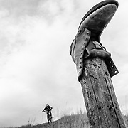 A boot along the edge of a single track in Wyoming. Heather Goodrich descending.