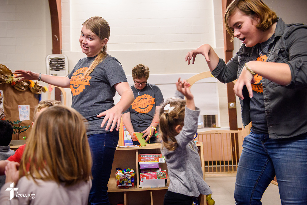 Young Adult Corps participants (L-R) Coretta Hedstrom, Laura Grundeman, and Rachel McCloskey play with the children at Little Blessings Daycare and Preschool in Trinity Lutheran Church, Boston, on Wednesday, Oct. 25, 2017. LCMS Communications/Erik M. Lunsford