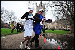 Tracey Crouch MP and Lord Addington  takes part in the MP's and Lords race against political Journalist in the Rehab Parliamentary Pancake Shrove Tuesday race a charity event which sees MPs and Lords joined by media types in a race to the finish. Victoria Tower Gardens, Westminster, Tuesday February 12, 2013. Photo By Andrew Parsons / i-Images
