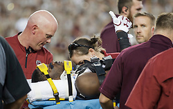 South Carolina wide receiver Terry Googer (6) gives a thumbs up while being carried away on a stretcher after being injured during the first quarter of an NCAA college football game against Texas A&M Saturday, Sept. 30, 2017, in College Station, Texas. (AP Photo/Sam Craft)