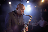 Saxophonist Performing in Jazz Club