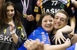 Gasper Marguc of Celje with fans Celjski grofje celebrate after winning the  handball match between RK Celje Pivovarna Lasko and RK Gorenje Velenje in final of Slovenian Cup 2013, on March 3, 2013 in Arena Tri Lilije, Lasko, Slovenia. Celje PL defeated Gorenje Velenje 28-24 and became Slovenian Cup Champion 2013. (Photo By Vid Ponikvar / Sportida)