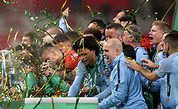 Manchester City's Leroy Sane (centre) celebrates with team mates after winning the Carabao Cup Final in the penalty shoot out