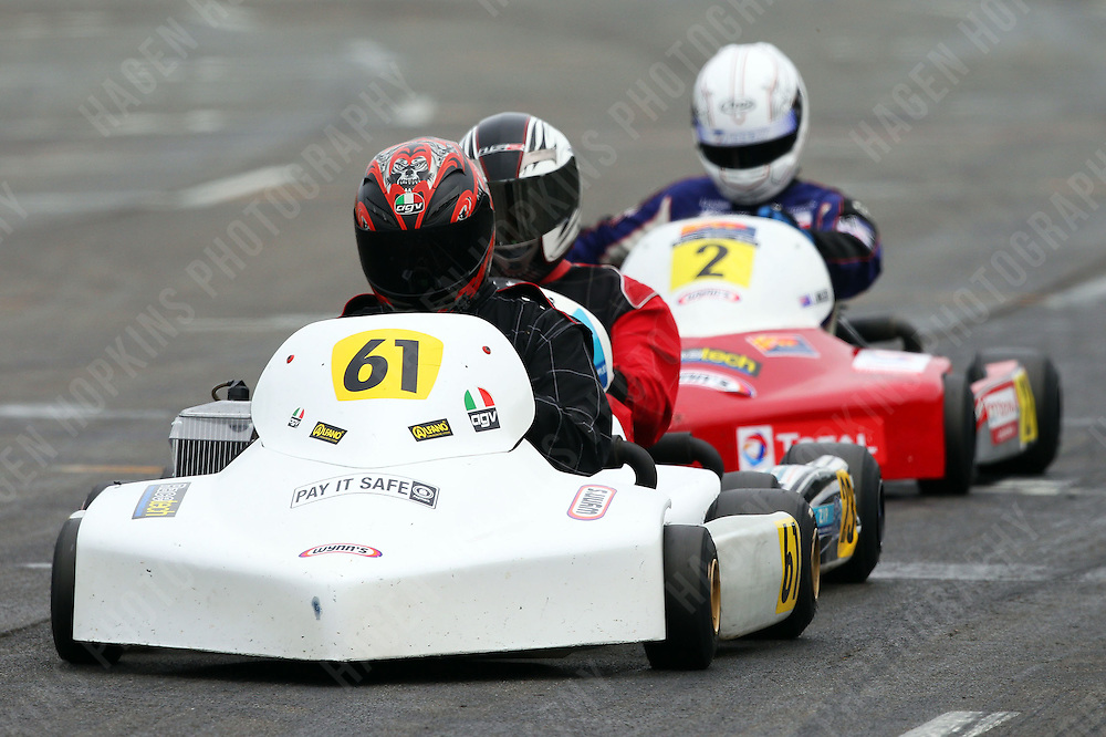 Lochlan Miller, 2, Clayton Merz, 23, and Derek Lawrence, 61, race in the Rotax Light class during the 2012 Superkart National Champs and Grand Prix at Manfeild in Feilding, New Zealand on Saturday, 7 January 2011. Credit: Hagen Hopkins.