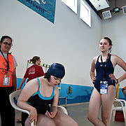Italy, Biella- XVIII Special Olympics National Games for mentally disabled people: a young athlete before a assisted swimming competition. 2012 © Mama2