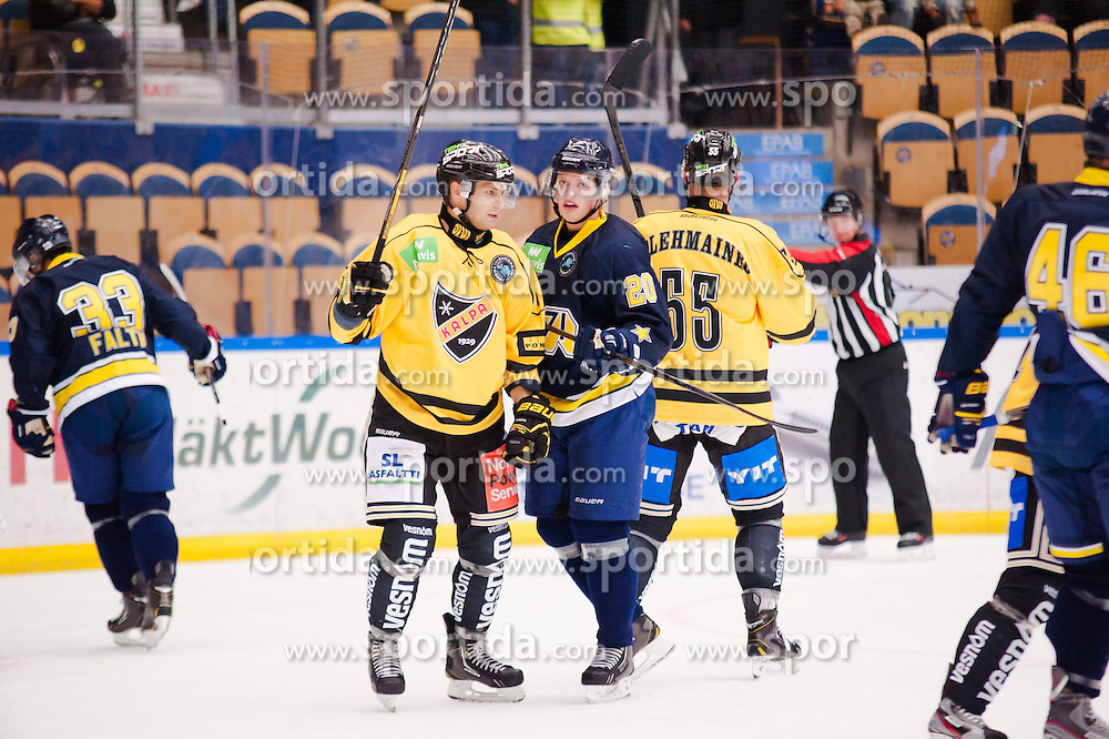 15.08.2013, Kinnnarps Arena, J&ouml;nk&ouml;ping, SWE, European Trophy, Hv71 vs Kalpa, im Bild Kalpa jublar efter sitt m&aring;l medans HV71 deppar // during the European Trophy Icehockey match betweeen Hv71 and Kalpa at the Kinnnarps Arena in J&ouml;nk&ouml;ping, Sweden on 2013/08/15. EXPA Pictures &copy; 2013, PhotoCredit: EXPA/ PicAgency Skycam/ Andreas Florin<br /> <br /> ***** ATTENTION - OUT OF SWE *****