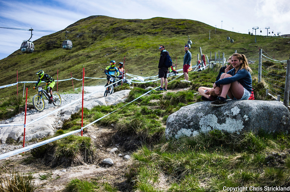 Nevis Range, Fort William, Scotland, UK. 3rd June 2016. Spectators enjoy the sun and a hot seat as the worlds leading mountain bikers descend on Fort William for the UCI World Cup on Nevis Range.