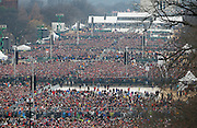 Crowds watch the inauguration ceremonies swearing in Donald Trump as the 45th president of the United States on the West front of the U.S. Capitol in Washington, U.S., January 20, 2017. REUTERS/Rick Wilking  - RTSWI70