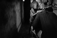 ©ANGOLA 2002. Following the end of the civil war in Angola a massive famine tormented the countryside, Camacupa..Picture featured in book KIDS photos by Markus Marcetic, published 2007.