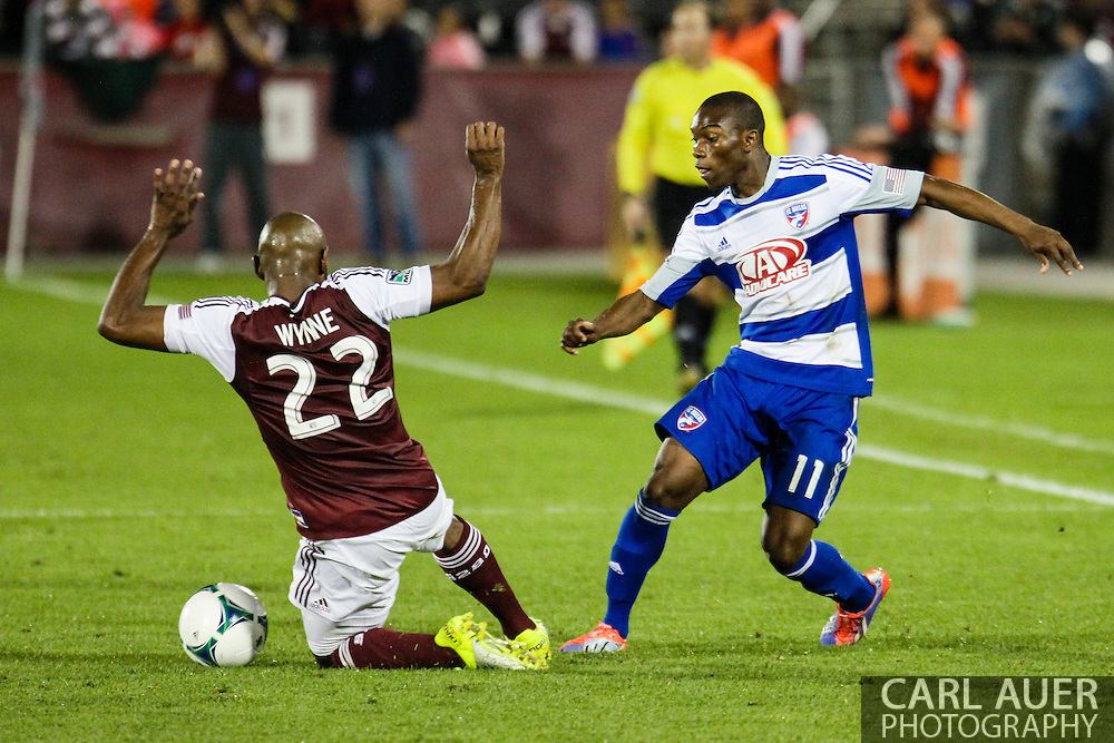 September 14th, 2013 -  FC Dallas forward Fabian Castillo (11) has the ball kicked away by Colorado Rapids defender Marvell Wynne (22) in the second half of the MLS Soccer game between FC Dallas and the Colorado Rapids at Dick's Sporting Goods Park in Commerce City, CO