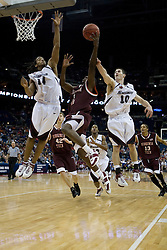 Virginia Tech Hokies Nigel Munson (3) attempts a shot over Southern Illinois Salukis forward Randal Falker (14). The #4 seed Southern Illinois Salukis defeated the #5 seed Virginia Tech Hokies 63-48 in the second round of the Men's NCAA Basketball Tournament at the Nationwide Arena in Columbus, OH on March 18, 2007.