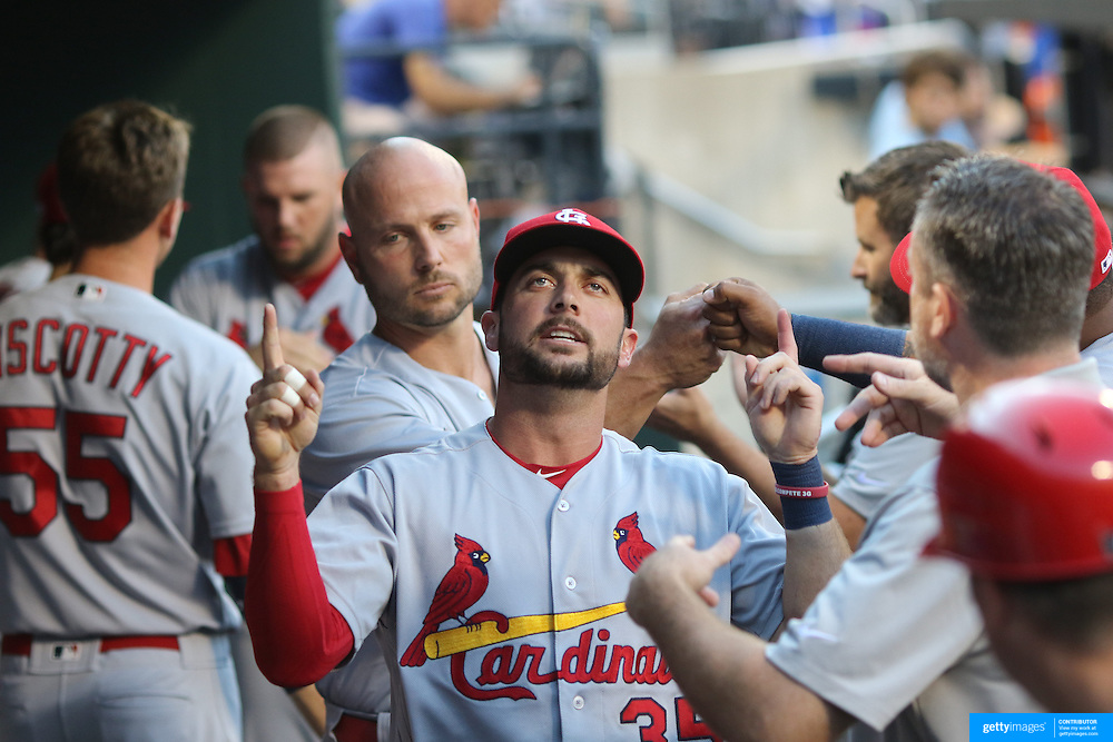 NEW YORK, NEW YORK - July 27: Greg Garcia #35 of the St. Louis Cardinals during his pre game ritual in the dugout before the St. Louis Cardinals Vs New York Mets regular season MLB game at Citi Field on July 27, 2016 in New York City. (Photo by Tim Clayton/Corbis via Getty Images)