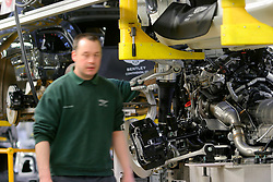 UK ENGLAND CREWE 5APR06 - Workers on the production line where the engine unit gets joined with the body of the car at the Bentley Factory in Crewe...jre/Photo by Jiri Rezac..© Jiri Rezac 2006..Contact: +44 (0) 7050 110 417.Mobile:  +44 (0) 7801 337 683.Office:  +44 (0) 20 8968 9635..Email:   jiri@jirirezac.com.Web:    www.jirirezac.com..© All images Jiri Rezac 2006 - All rights reserved.