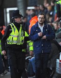Police escort Yeovil fans out of the stadium- Mandatory by-line: Nizaam Jones/JMP- 18/02/2017 - FOOTBALL - LCI Rail Stadium - Cheltenham, England - Cheltenham Town v Yeovil Town - Sky Bet League Two