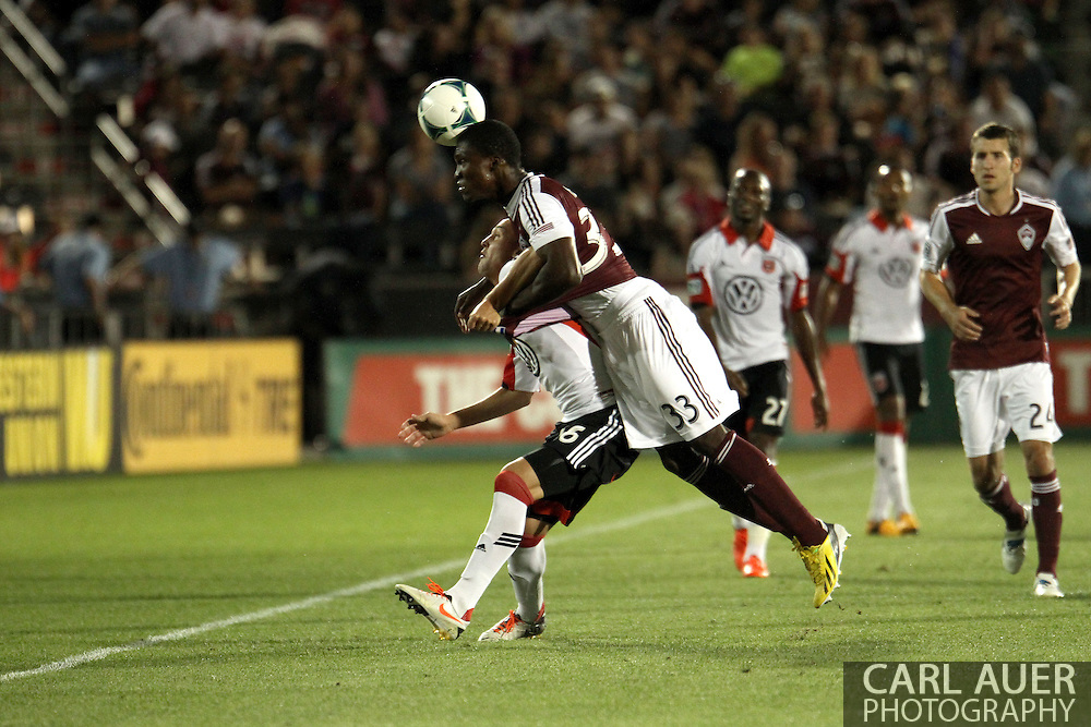 July 7th, 2013 - Colorado Rapids defender German Mera (33) goes over D.C. United forward Casey Townsend (16) to head the ball out of bounds during second half action of the Major League Soccer match between D.C. United and the Colorado Rapids at Dick's Sporting Goods Park in Commerce City, CO