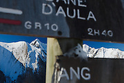 View of Mont Valier and GR10 signboards near Col de Pause, Ariege, Pyrenees, France.