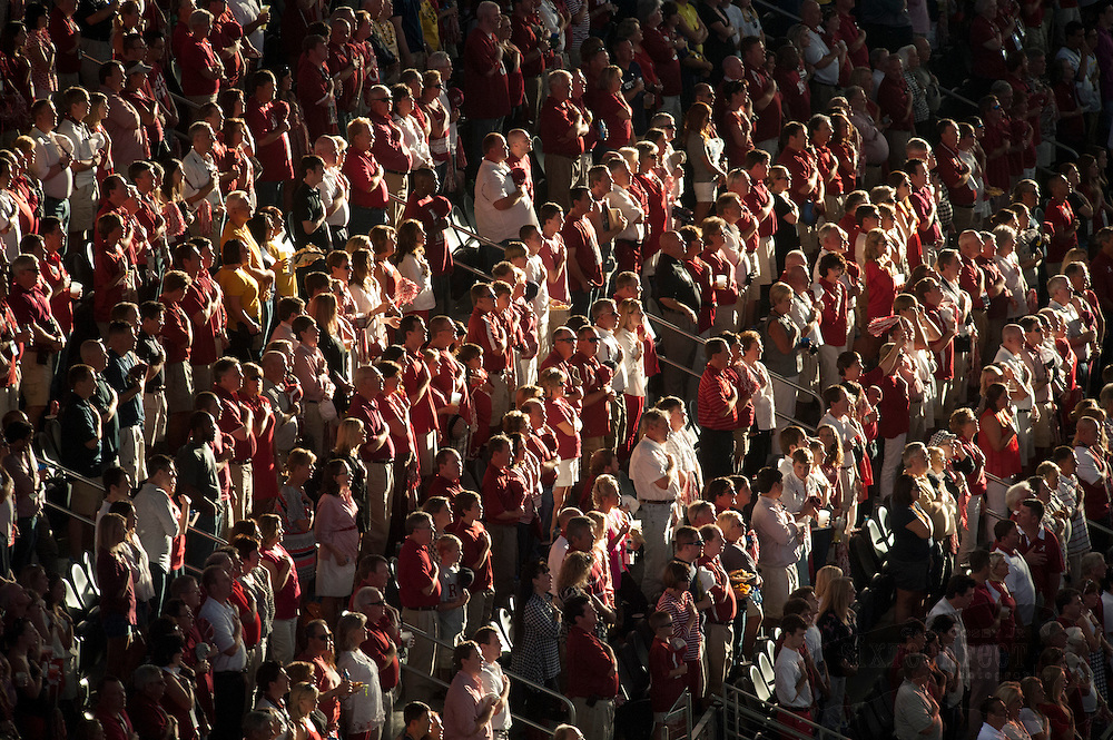 Daily Photo by Gary Cosby Jr.  ..Alabama fans salute the flag during the national anthem before the start  of the Alabama vs Michigan Cowboys Classic in Cowboys Stadium, Arlington, Texas Saturday, September 1, 2012.
