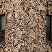 Art Deco Terracotta reliefs depicting animals and leaf themes run the whole length of the lower facade of the Chanin Building on 122 E 42nd Street cover of Lexington Avenue and 42nd Street.