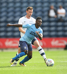 Christian Atsu of Newcastle United (Front) and Marnick Vermijl of Preston North End in action - Mandatory by-line: Jack Phillips/JMP - 22/07/2017 - FOOTBALL - Deepdale - Preston, England - Preston North End v Newcastle United - Pre-Season Club Friendly