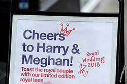 © Licensed to London News Pictures. 11/05/2018. WINDSOR, UK. A shop displays a message to the Royal couple as preparations continue in Windsor for the upcoming wedding between Prince Harry and Meghan Markle on 19 May.  Thousands of people are expected to visit the town for what has been billed as the wedding of the year.  Photo credit: Stephen Chung/LNP