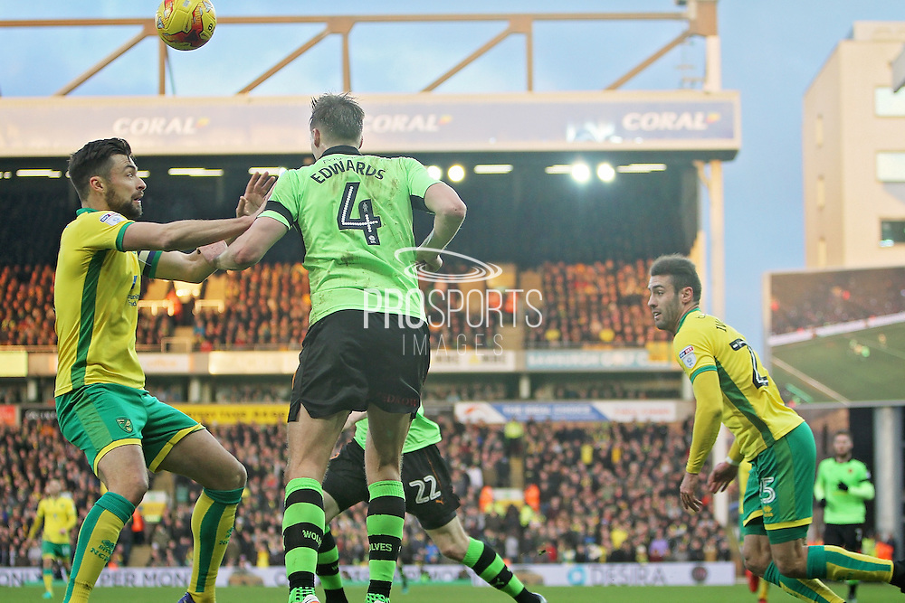 Wolverhampton Wanderers midfielder Dave Edwards (4) heads the ball into the box during the EFL Sky Bet Championship match between Norwich City and Wolverhampton Wanderers at Carrow Road, Norwich, England on 21 January 2017. Photo by Nigel Cole.