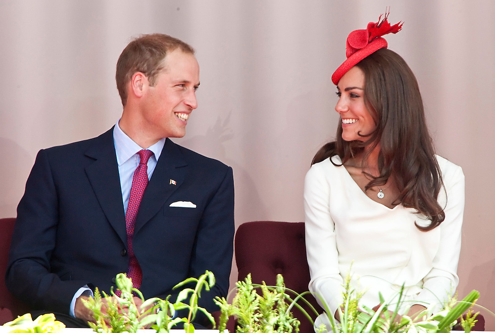 Britain's Prince William shares a moment with his wife Catherine the Duchess of Cambridge during Canada Day celebrations on Parliament Hill in Ottawa, Canada, July 1, 2011. The Duke and Duchess are on a nine day tour of Canada, their first official foreign trip as husband and wife.<br /> AFP PHOTO/GEOFF ROBINS