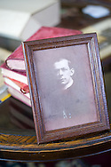 10 June 2015 Point Pleasant Beach USA/ Photo of the late priest  Father Thomas Roussel Davids Byles  (26 February 1870 – 15 April 1912) resting on books carried by was an English Catholic priest who famously remained on board the RMS Titanic as she was sinking after colliding with an iceberg, hearing confessions and giving absolution. The books were recently water damaged during Hurricane Sandy /  Michael Glenn For the Monitor