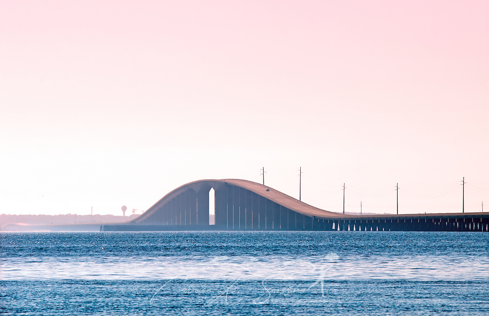 The Dauphin Island Bridge is pictured at sunrise. (Photo by Carmen K. Sisson/Cloudybright)