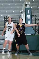 12 December 2015:  Maddie Merritt and Joann Wolfenberg during an NCAA women's basketball game between the Wisconsin Stevens Point Pointers and the Illinois Wesleyan Titans in Shirk Center, Bloomington IL