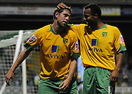 Yeovil - Tuesday, August 11th, 2009: Grant Holt of Norwich City celebrates his goal with Simon Whaley during the Carling Cup 1st Round match at Yeovil. (Pic by Alex Broadway/Focus Images)