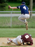 John S. Burke shortstop Drew Lallathin (4) leaps over Scott Heideman of James I. O'Neill while trying to catch the ball during a game in Goshen on Tuesday, May 3, 2011.