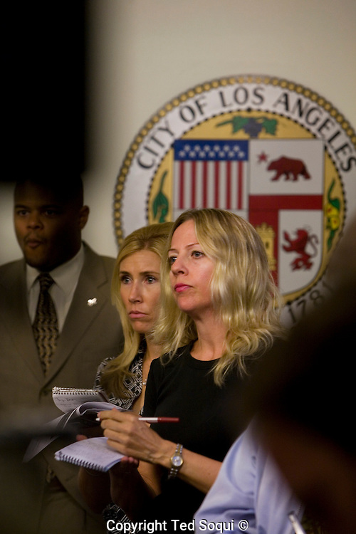 LA Weekly writer Christine Pelesik who broke the &quot;Grim Sleeper&quot; story.<br /> LA Council offers reward in &quot;Grim Sleeper&quot; Serial Killer Case.<br /> A $500,000 reward was offered today for information<br /> leading to the arrest and conviction of a serial killer believed to be responsible for at least 11 murders in South Los Angeles between 1985 and 2007.<br />    Dubbed the ``Grim Sleeper'' by the LA Weekly, the suspect has killed nine people in the city of Los Angeles, one in Inglewood and one in an unincorporated area of the county in the last 23 years.