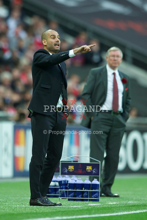 LONDON, ENGLAND, Saturday, May 28, 2011: FC Barcelona's head coach Josep Guardiola during the UEFA Champions League Final against Manchester United's manager Alex Ferguson at Wembley Stadium. (Photo by Chris Brunskill/Propaganda)