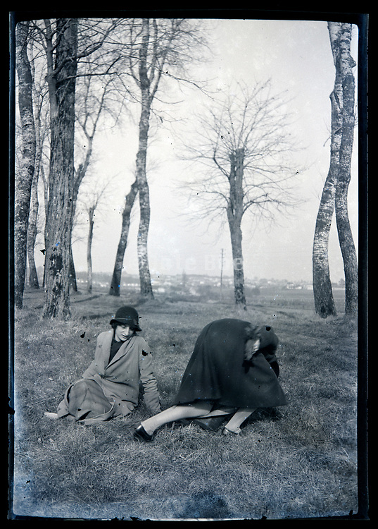 woman getting up in a rural landscape with a trees lined path France circa 1920s