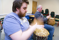 Two visually impaired men playing the drum during a drumming workshop at the NRSB activity day at their centre on Ortzen Street,  This is part of the IMPACT project; an interactive road show delivering a series of events designed to give the visionimpaired community of Nottinghamshire the opportunity to IMPACT on the future of Notts Royal Society for the Blind,