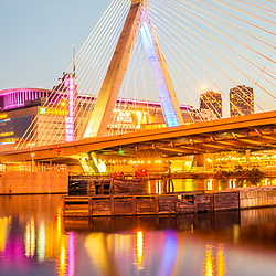 Boston Zakim Bunker Hill Bridge at night panorama photo. The Leonard P. Zakim Bunker Hill Memorial Bridge is a cable bridge that spans the Charles River in Boston, Massachusetts in the Eastern United States of America. Panoramic photo ratio is 1:3.
