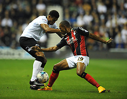 Derby County's Cyrus Christie is challenged by Bournemouth's Junior Stanislas - Photo mandatory by-line: Dougie Allward/JMP - Mobile: 07966 386802 - 30/09/2014 - SPORT - Football - Derby - Pride Park - Derby County v AFC Bournemouth - Sky Bet Championship